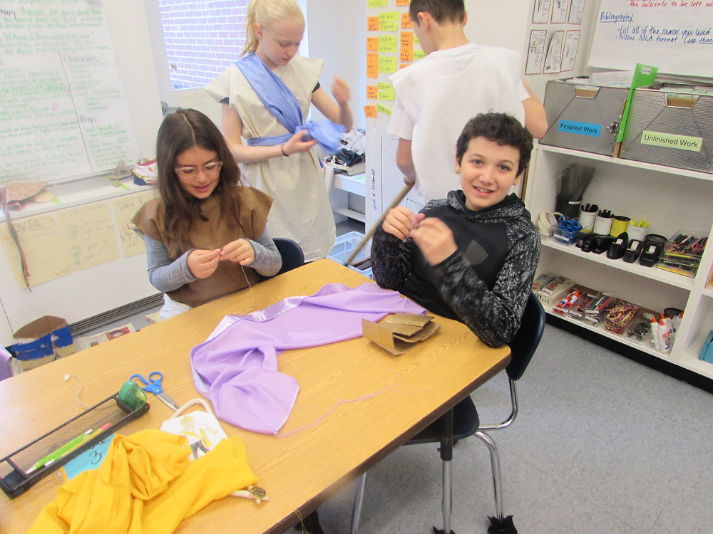 Ian Allard-Neptune and Talia Fuller sewing costumes for their group  play