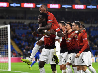 (From right to left): Paul Pogba (middle), captain Ashley Young (top), Ander Herrera, Jesse Lingard, Andreas Pereira, and Fred celebrating a goal scored in the Cardiff City vs. Manchester United game. They are seen here as clearly jubilant.