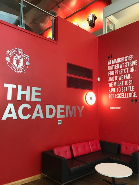 An original photo of Sir Matt Busby's famous quote in Manchester United's Academy Building Complex