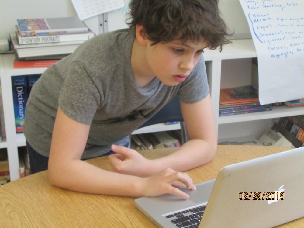 Benjamin Squires, XlsD working on his computer