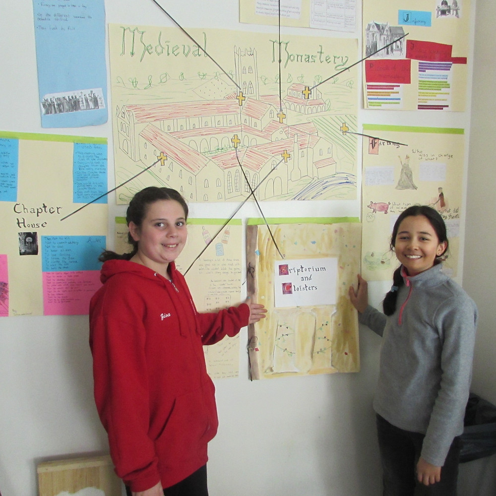 Ziva Salan and Zoe Manges displaying their Medieval posters