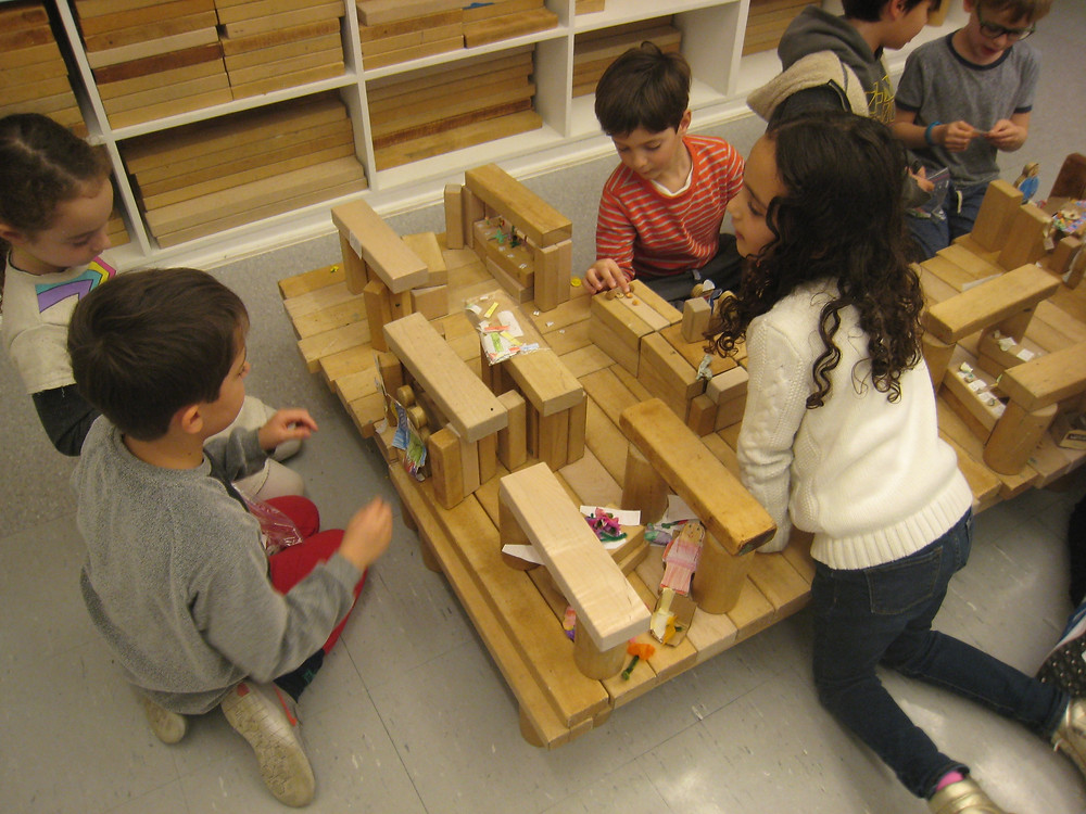 Seven VIsT students working on recreating the Union Square Holiday Market