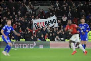 "Fans holding up a poster saying ""20LEGEND"" during the Leicester City vs. Manchester United match"