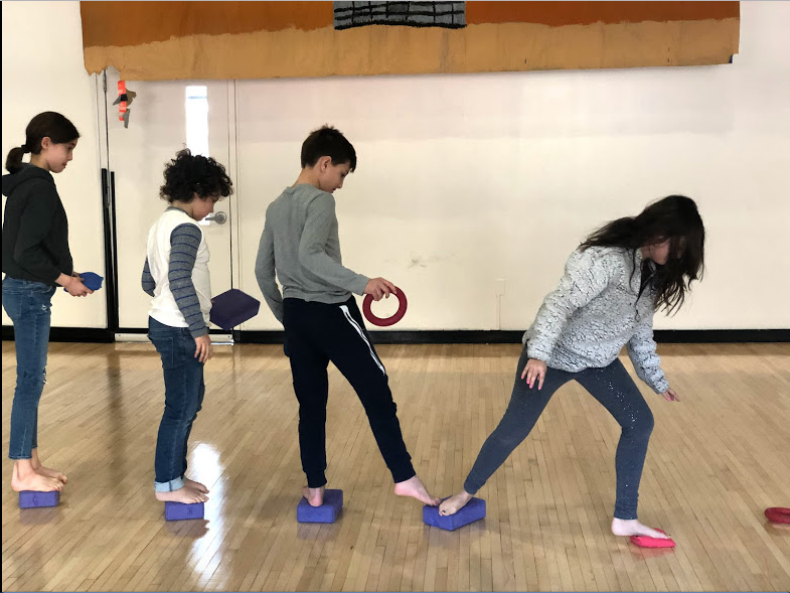 """From left to right: Elena Chirinos, Giacomo Cender, Cyrus Taber and Tate Collins, IXsK, playing """"the Floor is Lava"""" in Rhythms"""
