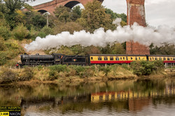 Steaming by The River