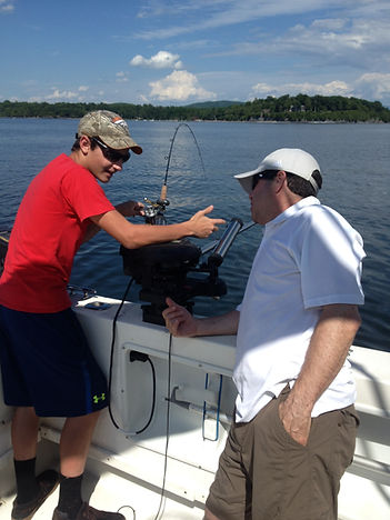 First Mate Ira talking with client