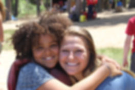 Counselor Hugging and Smiling at Lake.jp