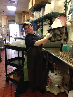Reid cleaning in the kitchen