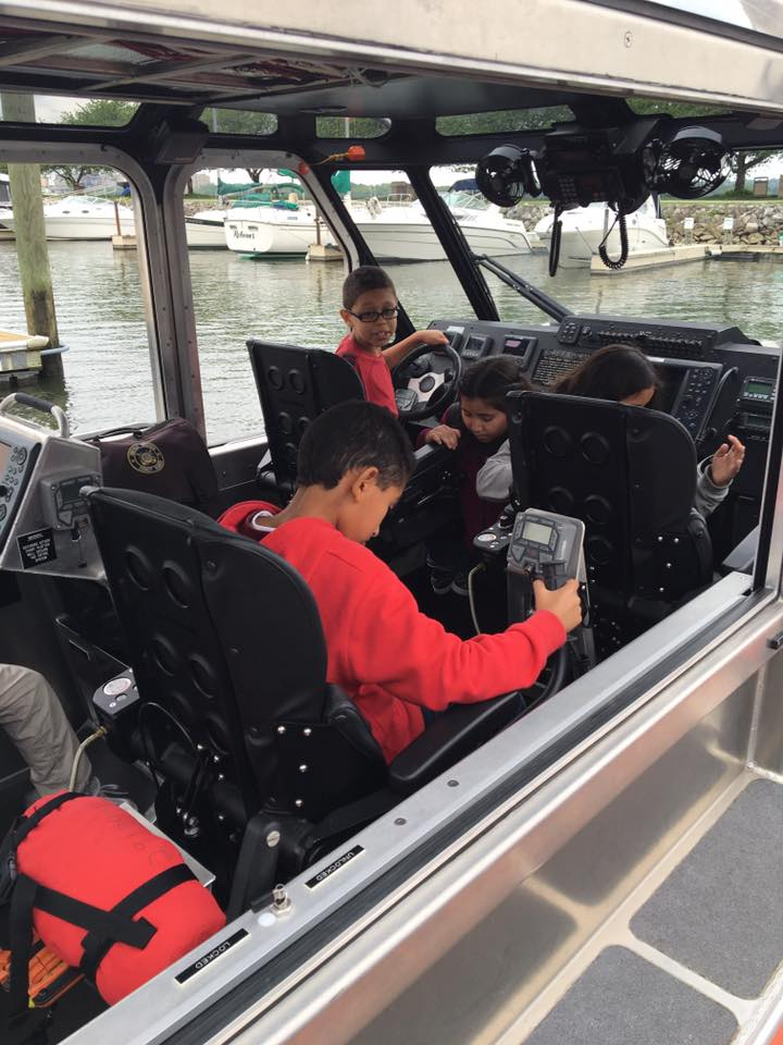 WHS USCG kids with tech on boat 2