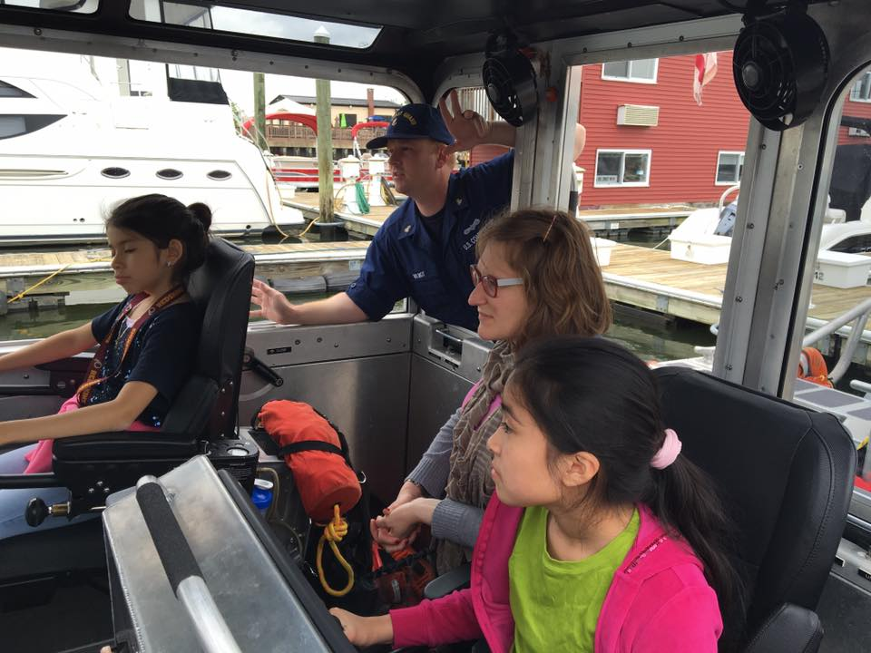 WHS USCG kids on boat with Coastie