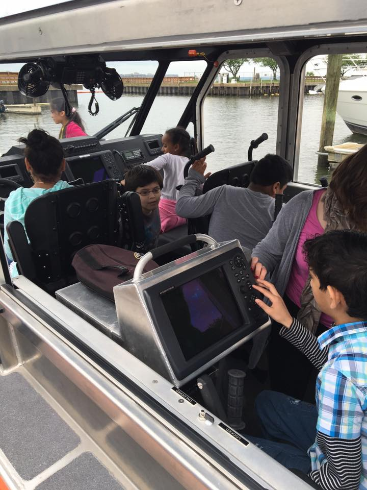 WHs USCG kids with tech on boat