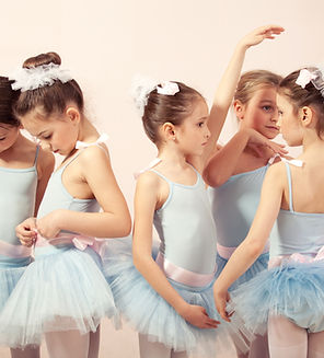 Group of five little ballerinas posing t