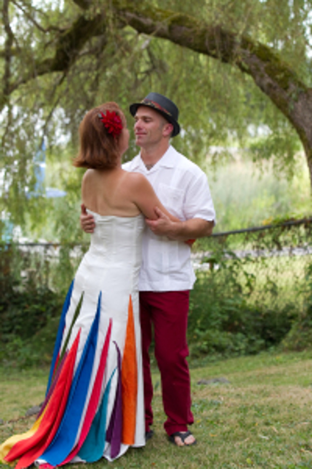 DIY wedding dress that was perfect for me, and his red pants that he wore until he accidentally poured bleach on them a year later.