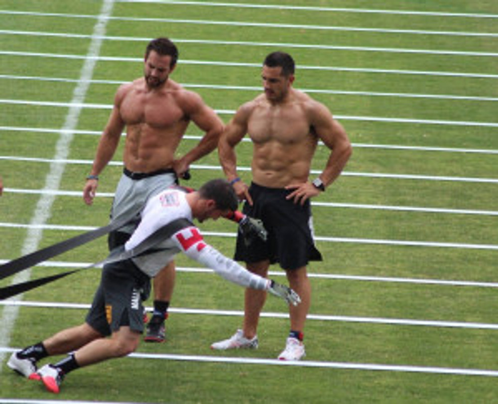 "Froning and Khalipa cheering on another ""competitor"" who is still working. Because that's what we do in CrossFit."