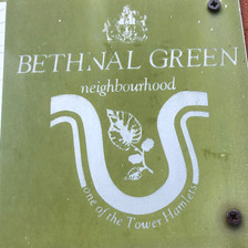 Bethnal Green road signs with the symbol of a mulberry leaf and berries