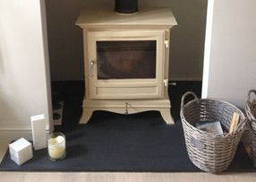 dark grey slate hearth with woodburner