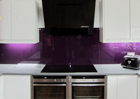 purple glass splashback in kitchen