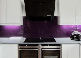 purple glass splashback in kitchen