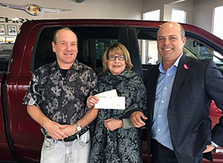 Parkers Chrysler and Janet Parker donate $30,900 to Discovery House.