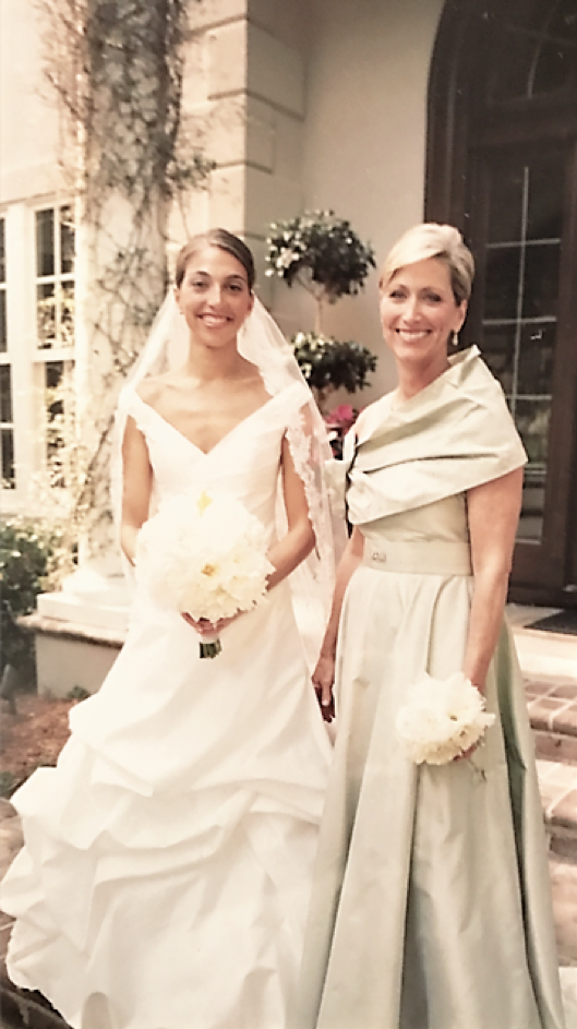 Lisa S. Rice poses with her daughter Ann E. Rice Ervin, both in their custom Romona Keveza gowns.