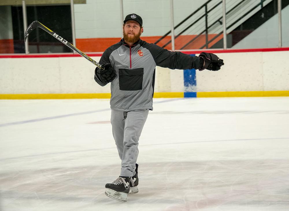Tyler Maxwell running a practice.