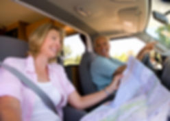 Mature woman reading map in motor home w