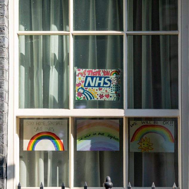 Rainbow and NHS posters in the window of 10 Downing Street