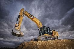 estrazione di misto cava tramite escavatore caterpillar