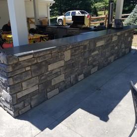 Stone veneer install on outdoor kitchen