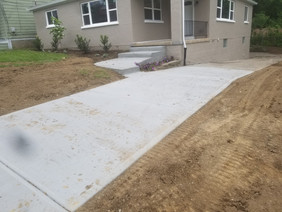 Concrete driveway steps and landscape in