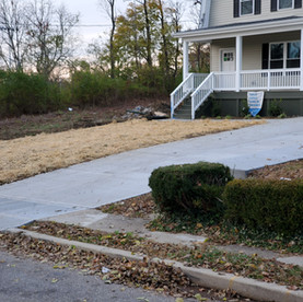 Concrete driveway install and landscape