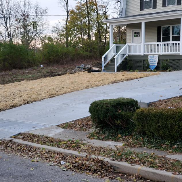 Concrete driveway install and landscape