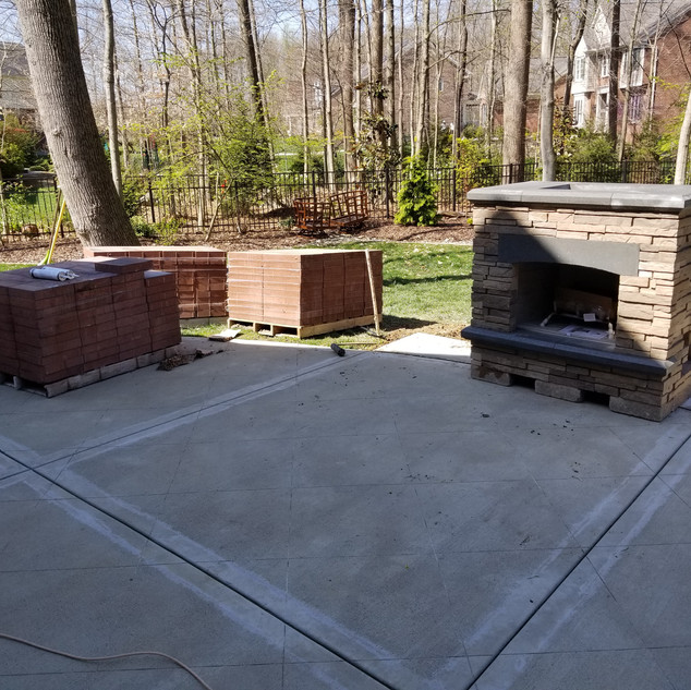 Fireplace and concrete patio overlay