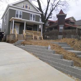 Concrete drive, retaining wall, landscap