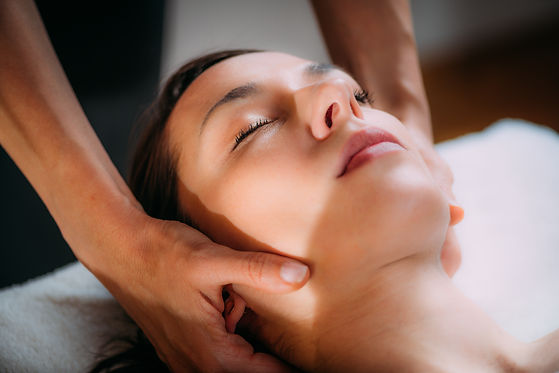 Cranial osteopathy massage. Therapist massaging woman's head..jpg