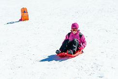 little-girl-sledding-at-sierra-nevada-sk
