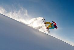 girl-snowboarder-jumping-front-flip-leav