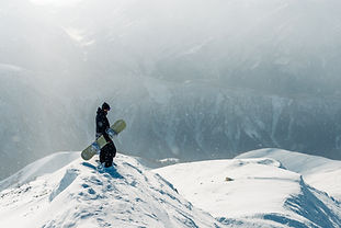 man-stay-and-watch-with-snowboard-equipm