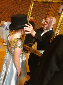 Lord Right gives his top hat to a girl