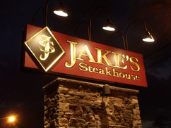 Jakes Carved Sign on Brick Pillar