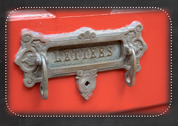 Old fashion letter slot on a red door