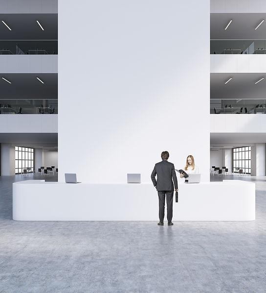 Reception in modern office. Man and woma