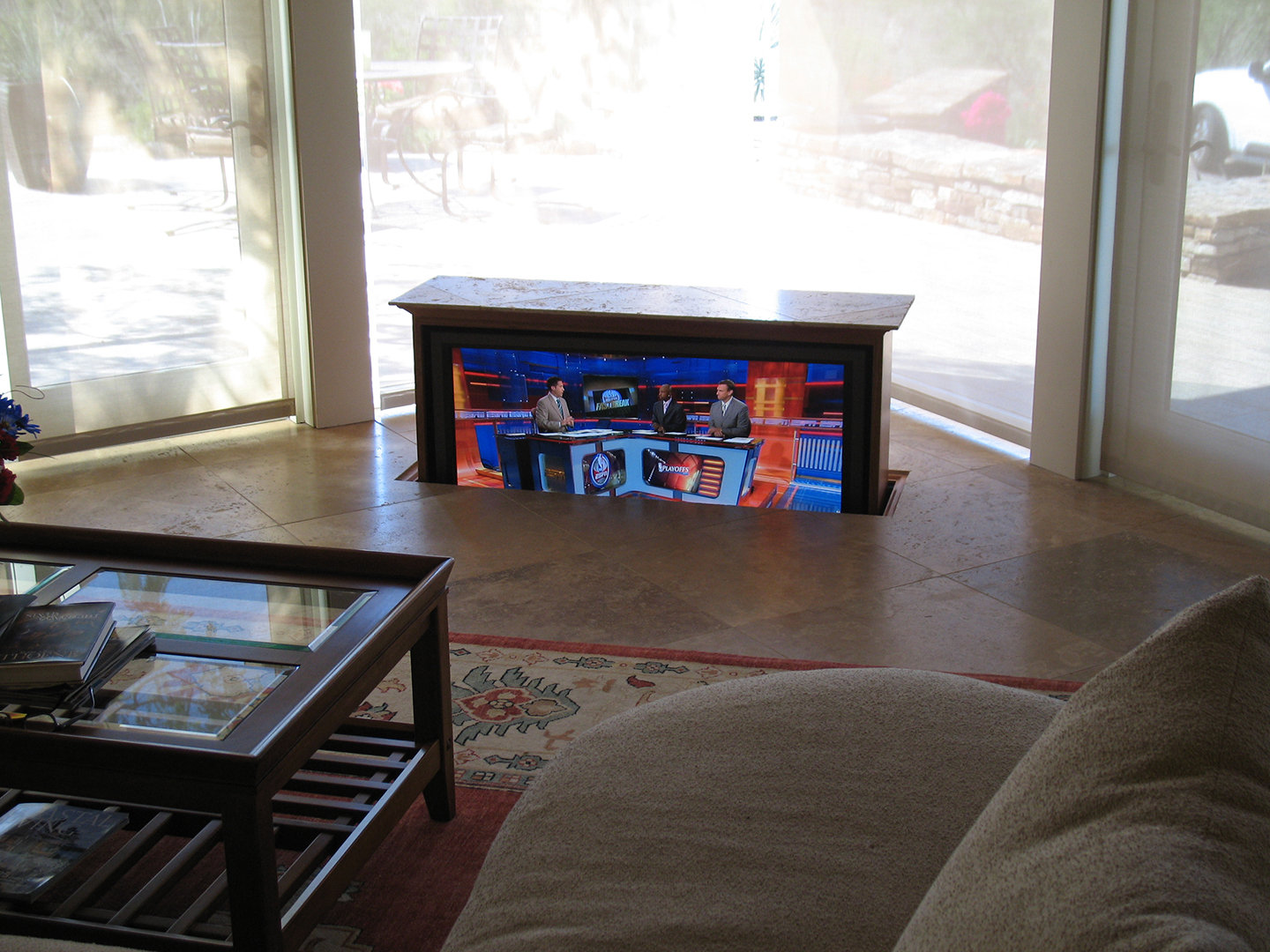 TV stand that lifts out of the floor