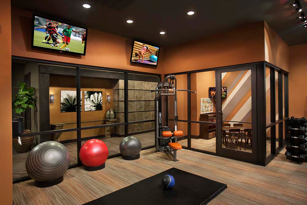 Exercise room with hanging TVs