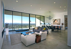 Modern open living room w/ a view