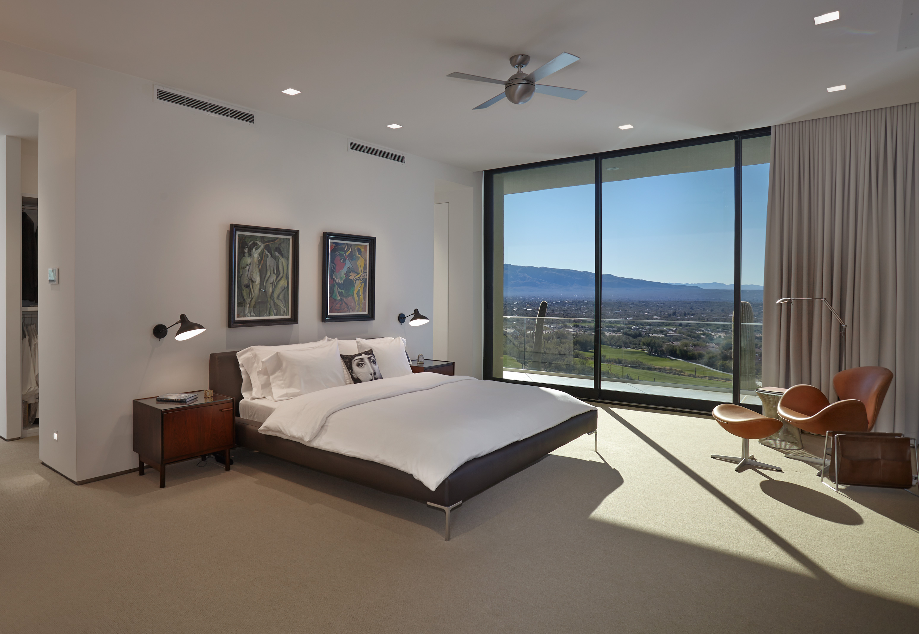Upscale modern bedroom w/ a view