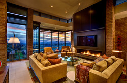 Living room with a fire and a view
