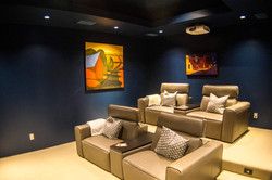 Home theater with art and projector