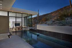 Luxury pool near large windows
