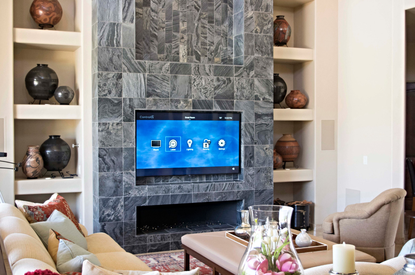 TV hanging above a marble fireplace